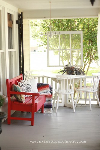 grey porch floor with red and white accents