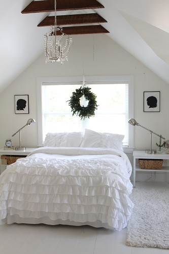 a white attic bedroom
