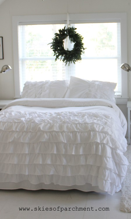 white ruffled bedspread