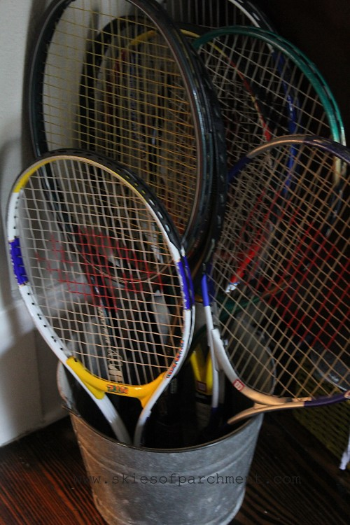 a collection of tennis rackets